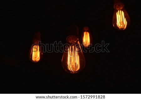 Vintage light bulb that gives light and creates an atmosphere. #1572991828