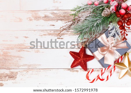 Christmas holidays composition with copy space for your text on white wooden background.