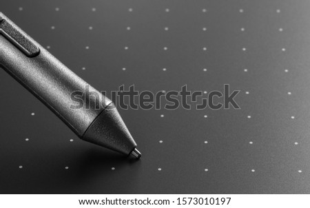 Close up shot of Graphic tablet with pen for illustrators and designers. Graphic design instrument. #1573010197