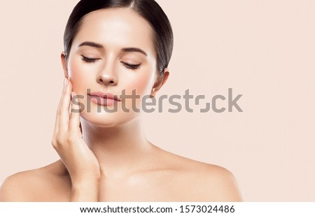 Woman beauty face healthy skin color background natural makeup #1573024486