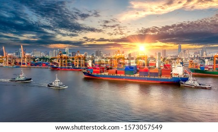 Aerial view of cargo ship, cargo container in warehouse harbor at thailand, container ship in import export and business logistic with sunset #1573057549