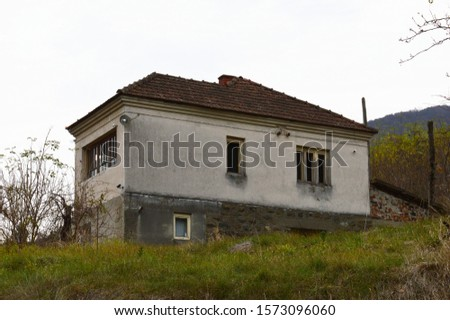 an old ruined, abandoned village house #1573096060