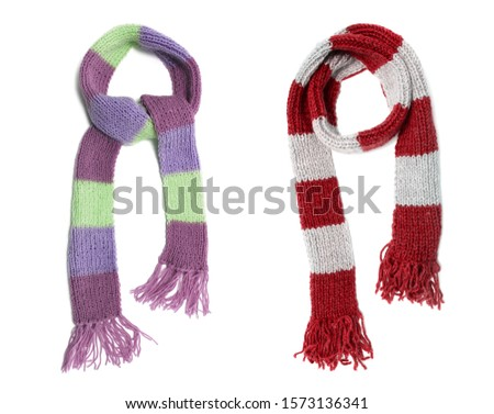 Knitted scarf on a white background. #1573136341