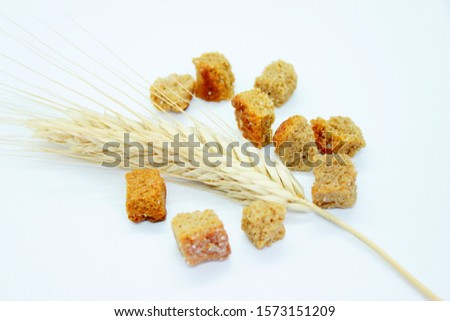 Rye crackers and rye spike located on a white background #1573151209