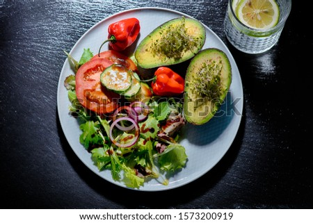 avocado with green salad, tomatoes, snake cucumber, red onions and chillies #1573200919
