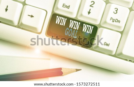 Text sign showing Win Win Win Goal. Conceptual photo Approach that aims to satisfy all parties involved White pc keyboard with empty note paper above white background key copy space. #1573272511