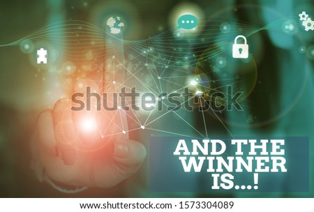 Handwriting text And The Winner Is. Concept meaning announcing who got first place at competition or exam Picture photo system network scheme modern technology smart device. #1573304089