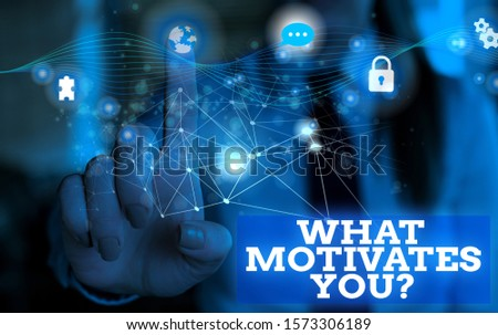 Handwriting text What Motivates Youquestion. Concept meaning know reasons why you want to wake up each morning Picture photo system network scheme modern technology smart device. #1573306189