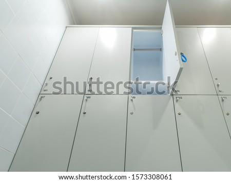 one door of set locker opened with empty in exercise bathroom #1573308061