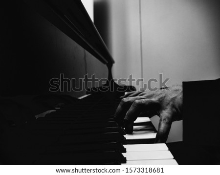 piano player closeup in black and white #1573318681