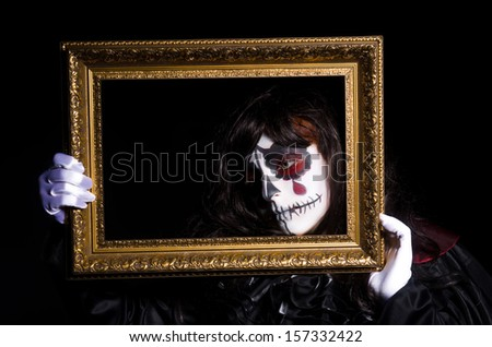 Monster with picture photo frame in dark room0