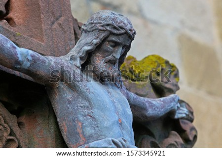 The symbol of Christianity. Detail of the cross and Jesus on the cross #1573345921
