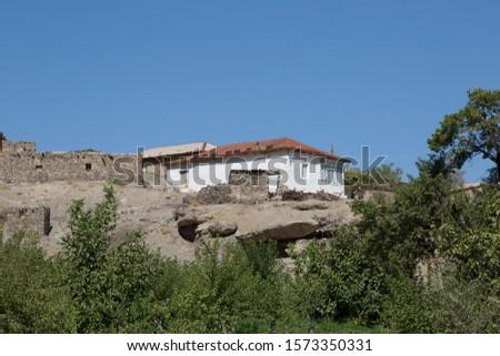 Old houses in a mountain village in Uzbekistan #1573350331