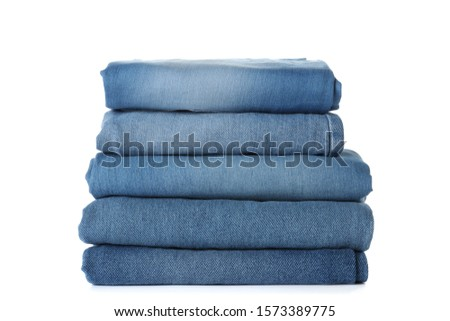 Stack of different jeans isolated on white #1573389775