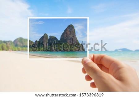 Hand With Postcard of Beach. Thailand, Krabi Province, Railay Beach