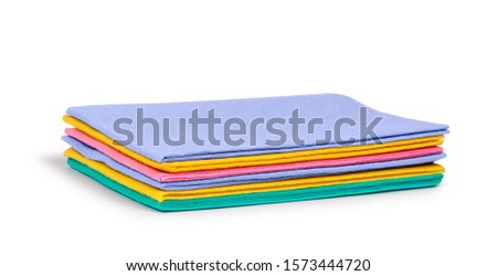 multi-colored stack of cleaning rags on an isolated white background #1573444720