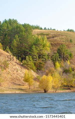 Autumn landscape, dark blue water, last warm days, river, trees, windy weather, yellow-red autumn leaves #1573445401