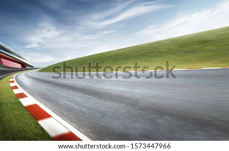 Wide angle view empty asphalt international curvy racetrack , motion blur effect apply . Daytime scene . #1573447966