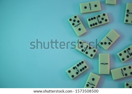 Beautiful vintage domino in the color light. Background banner texture. Top View. #1573508500