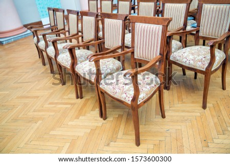 Elite seats, comfortable armchairs, Conference room with brown many armchairs . Many empty armchairs. #1573600300