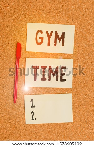 Conceptual hand writing showing Gym Time. Business photo showcasing a motivation to start working out making exercises fitness Empty sticker reminder memo billboard corkboard desk paper. #1573605109