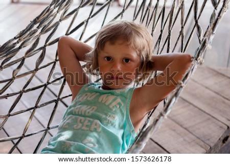 Girl in hammock. Relax. Childhood. Kid's adventure. Resting. #1573626178