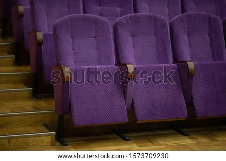 purple velvet seats for spectators in the theater or cinema #1573709230