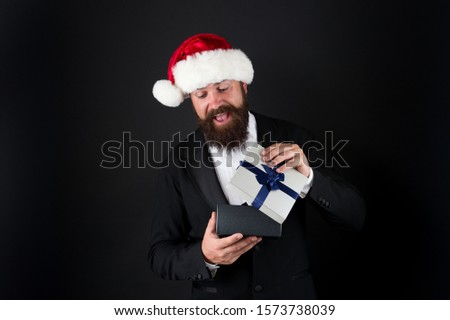 Boxing day. Corporate christmas party. Man bearded hipster santa hat. Christmas spirit concept. Manager celebrate new year. Cheerful mood. Christmas party. Corporate holiday ideas. Happiness and joy. #1573738039