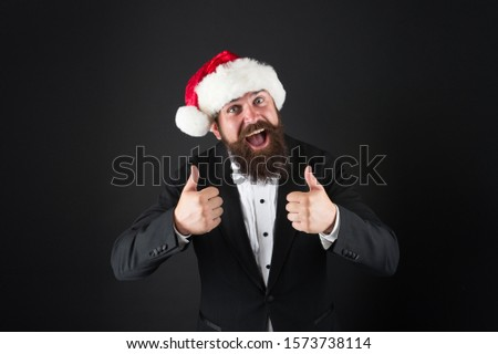 Cheerful mood. Happiness and joy. Corporate christmas party. Man bearded hipster wear santa hat. Christmas spirit concept. Manager celebrate new year. Christmas party. Corporate holiday ideas. #1573738114