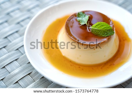 Pudding Caramel Custard with top view of a creme caramel, caramel custard or custard pudding in white plate. #1573764778