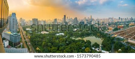 Panorama City public Lumpini park colorful sky with cloud sunset dawn Bangkok Thailand #1573790485