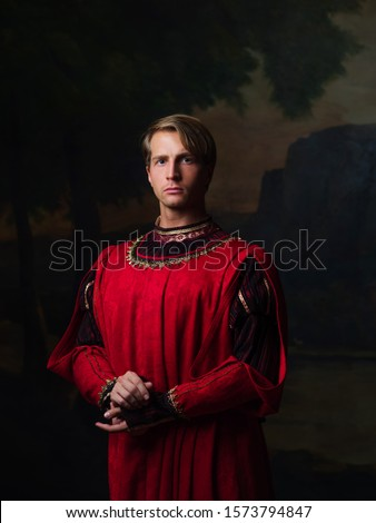 handsome man in a Royal red doublet. Young man, portrait in Renaissance style paintings #1573794847