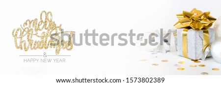 Christmas silver and gold gift box with decoration on white background #1573802389
