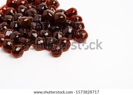 A picture of pearl tea or some call tapioca pearl used for boba tea on white background. Boba tea is a trending drink in Malaysia.