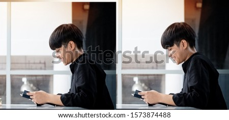 The abstract art design background of Asian teenager reading book with interested feeling,blurry light around #1573874488