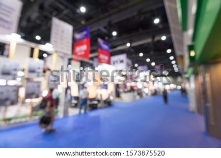 Abstract blur people in exhibition hall event trade show expo background. Large international exhibition, convention center, MICE industry business concept #1573875520