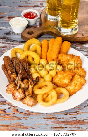 Assortment of beer in assortment on a white plate #1573932709