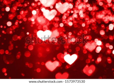 Festive overlay effect. Red and pink heart bokeh festive glitter background. Christmas, New Year and Valentine's day design.