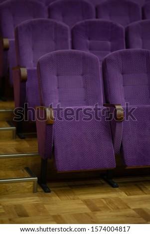 purple velvet seats for spectators in the theater or cinema #1574004817