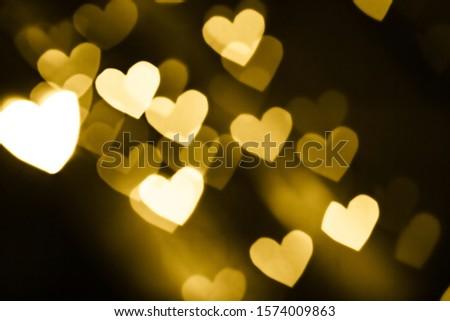 Festive overlay effect. Golden heart bokeh festive glitter background. Christmas, New Year and Valentine's day design