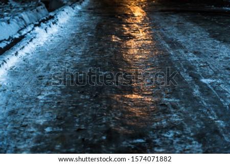 icy road night light winter Royalty-Free Stock Photo #1574071882