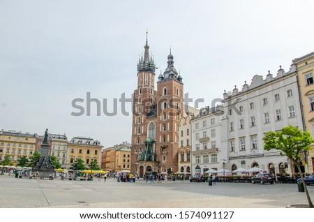 Krakow/ Poland- August 7 2019: Maria basilica and market square. #1574091127