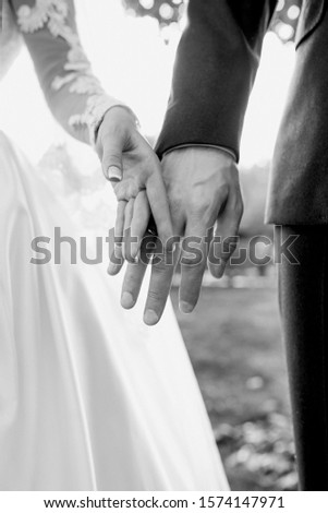 hands of wedding couple  in love. Relationship, love and tenderness concept #1574147971
