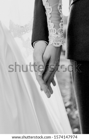 hands of wedding couple  in love. Relationship, love and tenderness concept #1574147974