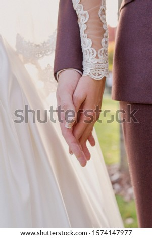 hands of wedding couple  in love. Relationship, love and tenderness concept #1574147977