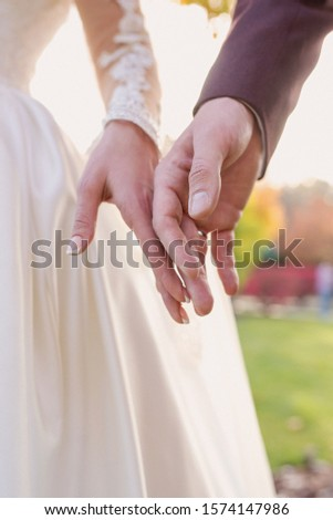 hands of wedding couple  in love. Relationship, love and tenderness concept #1574147986