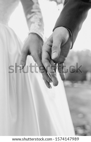 hands of wedding couple  in love. Relationship, love and tenderness concept #1574147989