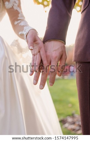hands of wedding couple  in love. Relationship, love and tenderness concept #1574147995