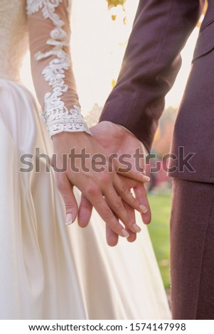 hands of wedding couple  in love. Relationship, love and tenderness concept #1574147998