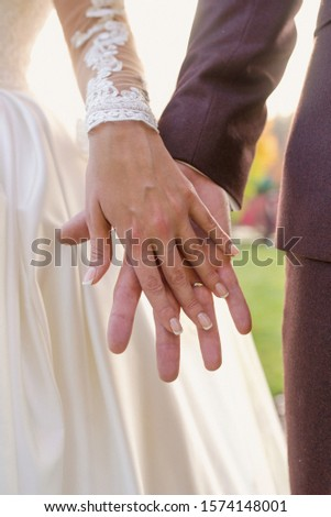 hands of wedding couple  in love. Relationship, love and tenderness concept #1574148001